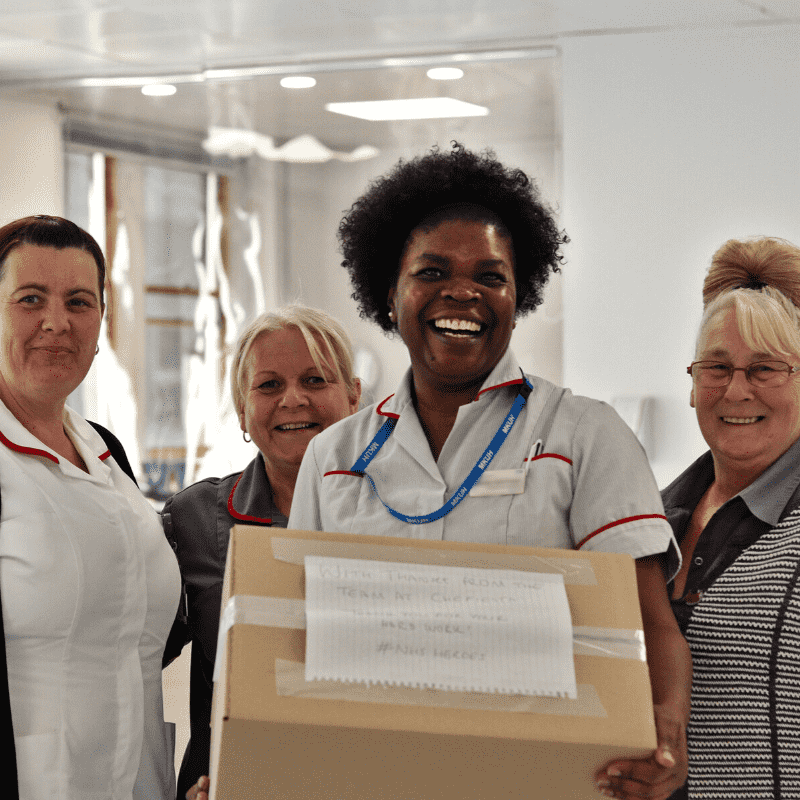 4 Nurses holding a box of meals - NHS, NHS heroes, Chefiesta, Meal Prep, Meal prep company, Meal prep near me, Catering company, private dining