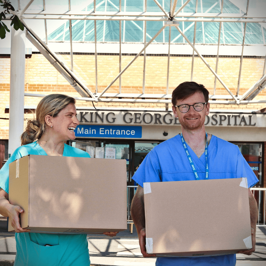 2 nurses holding their meal prep order in front of King George hospital
