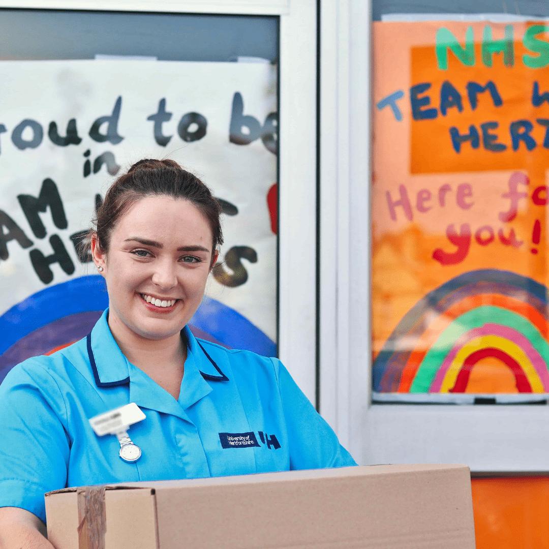 Nurse holding meal prep order - meal delivery service, NHS, Hertfordshire